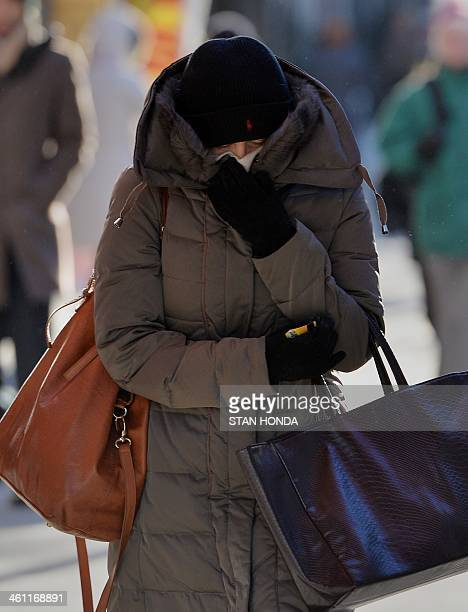 A woman bundled against the cold walks on East 86th Street on the east side of Manhattan January 7 2014 in New York as frigid weather grips the...