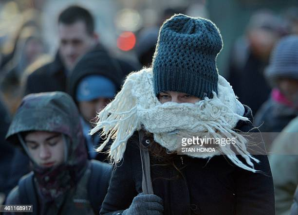 A woman bundled against the cold walks on the east side of Manhattan January 7 2014 in New York as frigid weather grips the northeast A blast of...