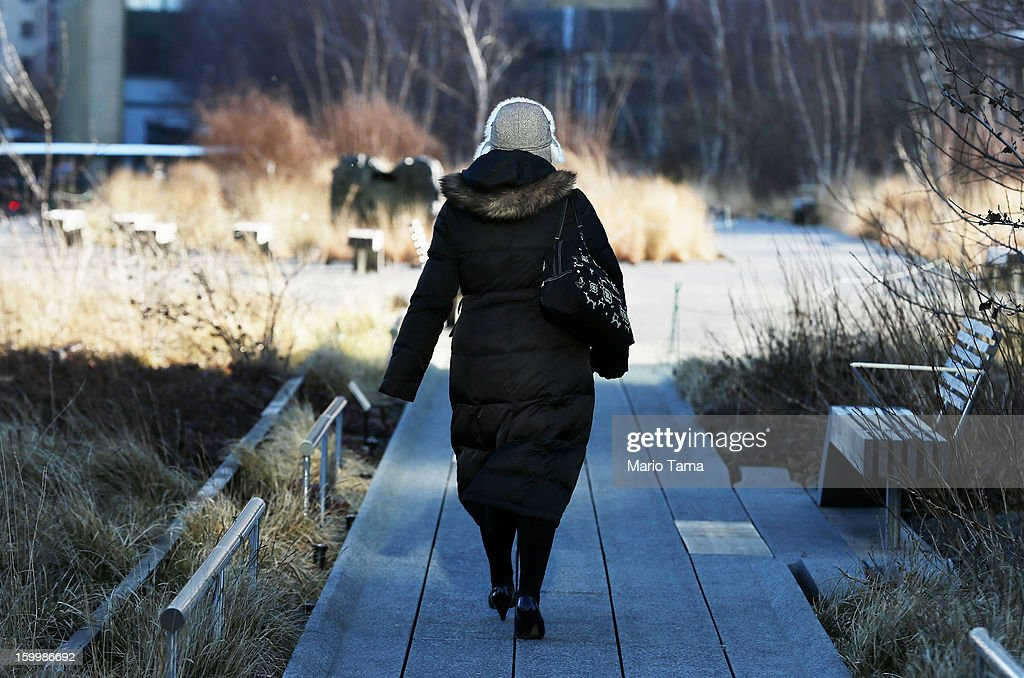 A woman bundled up against the cold walks through the High Line park in Manhattan on January 24, 2013 in New York City. Polar air settled in over the northwest U.S. Wednesday, with temperatures in the teens and twenties.