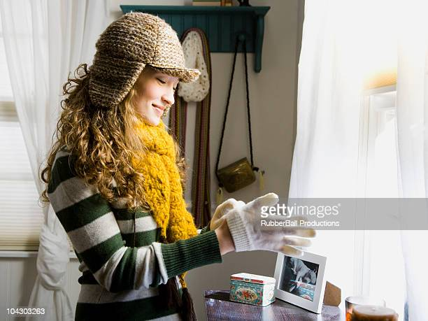 woman bundling up to go out into the cold - warm clothing stock pictures, royalty-free photos & images