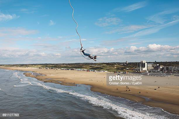 woman bungee jumping at beach - bortes stock pictures, royalty-free photos & images