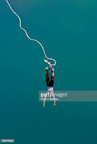 Woman bungee jumping in New Zealand.