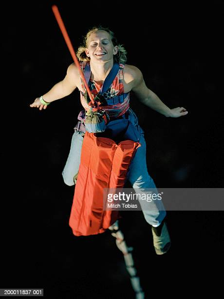 Woman bungee jumping, overhead view