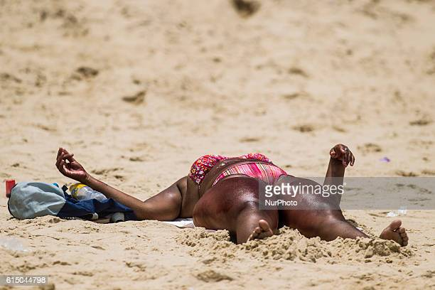 Woman burns during sunbathing on the beach of Boa Viagem Recife in northeastern Brazil on October 16 2016 The beach is known internationally for...