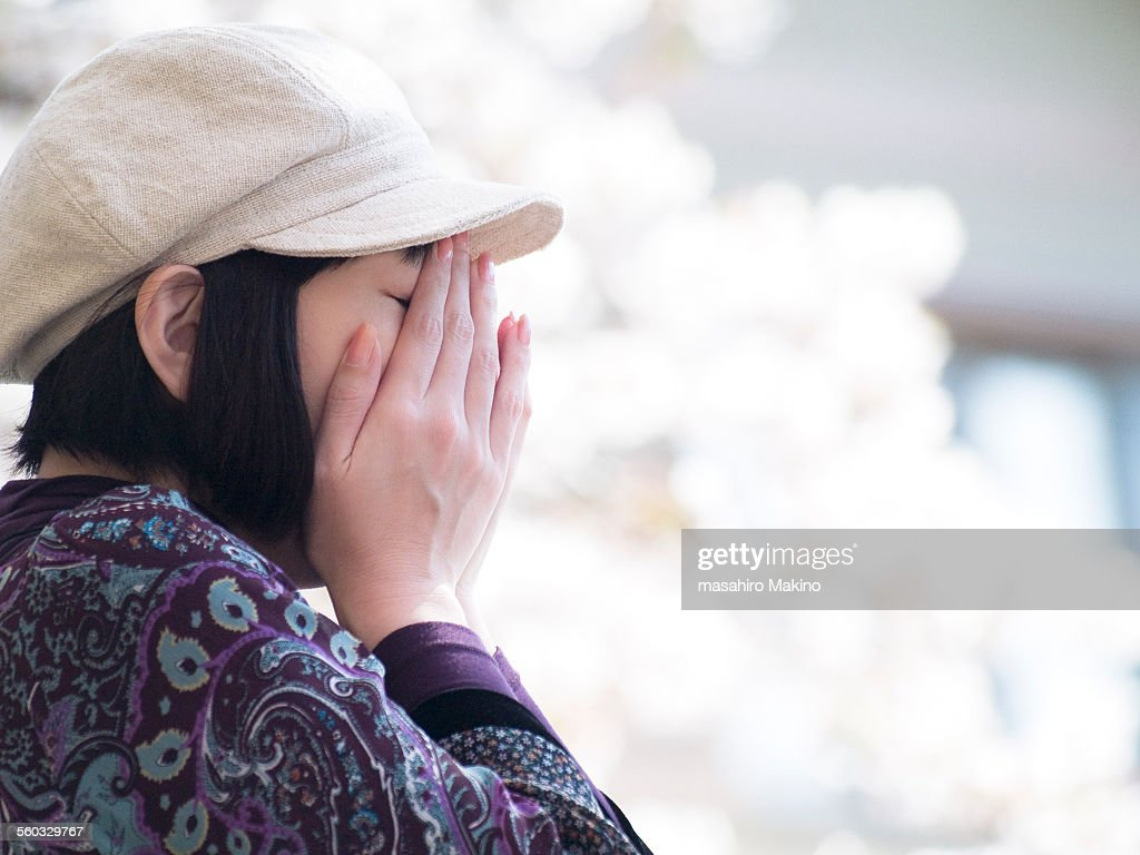 Woman Burying Her Face in Her Hands : ストックフォト