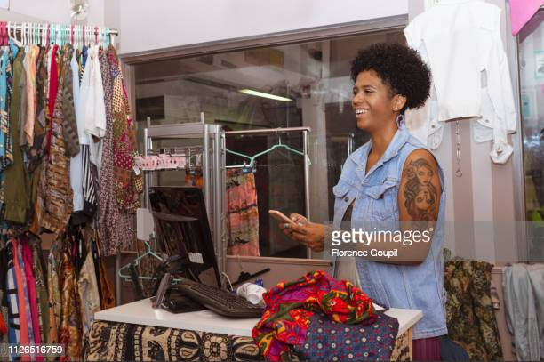 African American woman entrepreneur at her clothing shop