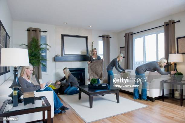 Woman Busy Cleaning Living Room