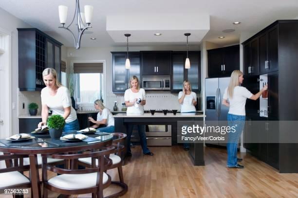 woman busy in kitchen - nur erwachsene fotos stock-fotos und bilder