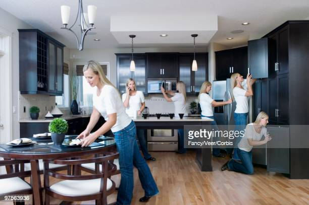 woman busy in kitchen - repetition stock pictures, royalty-free photos & images