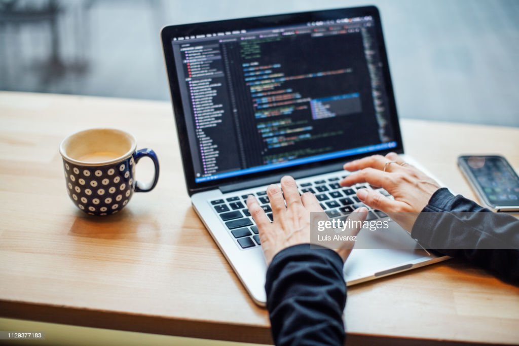 Woman busy working on her laptop at cafe : Stock Photo