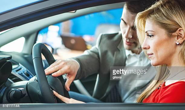 Woman buying a car.