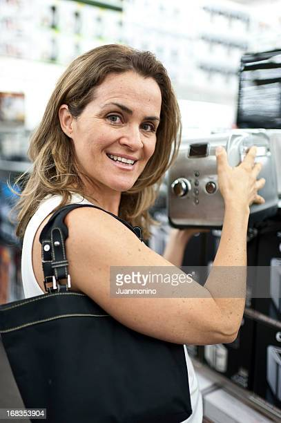 woman buying a toaster - toaster appliance stock pictures, royalty-free photos & images