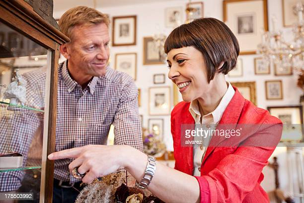Woman buying at an antique store
