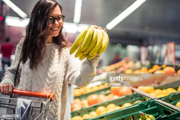 Woman buying bananas