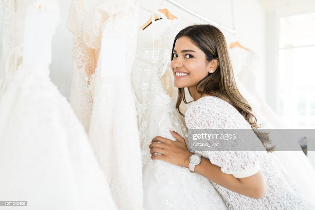 Woman Buying Beautiful Marriage Gown In Store : Stock Photo