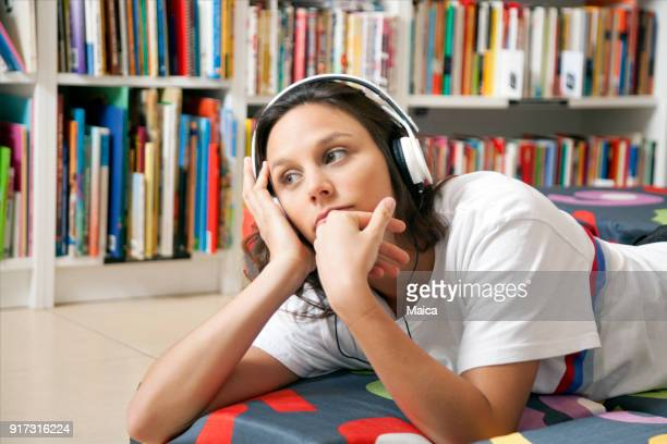 woman buying books at a bookstore - audio equipment stock pictures, royalty-free photos & images