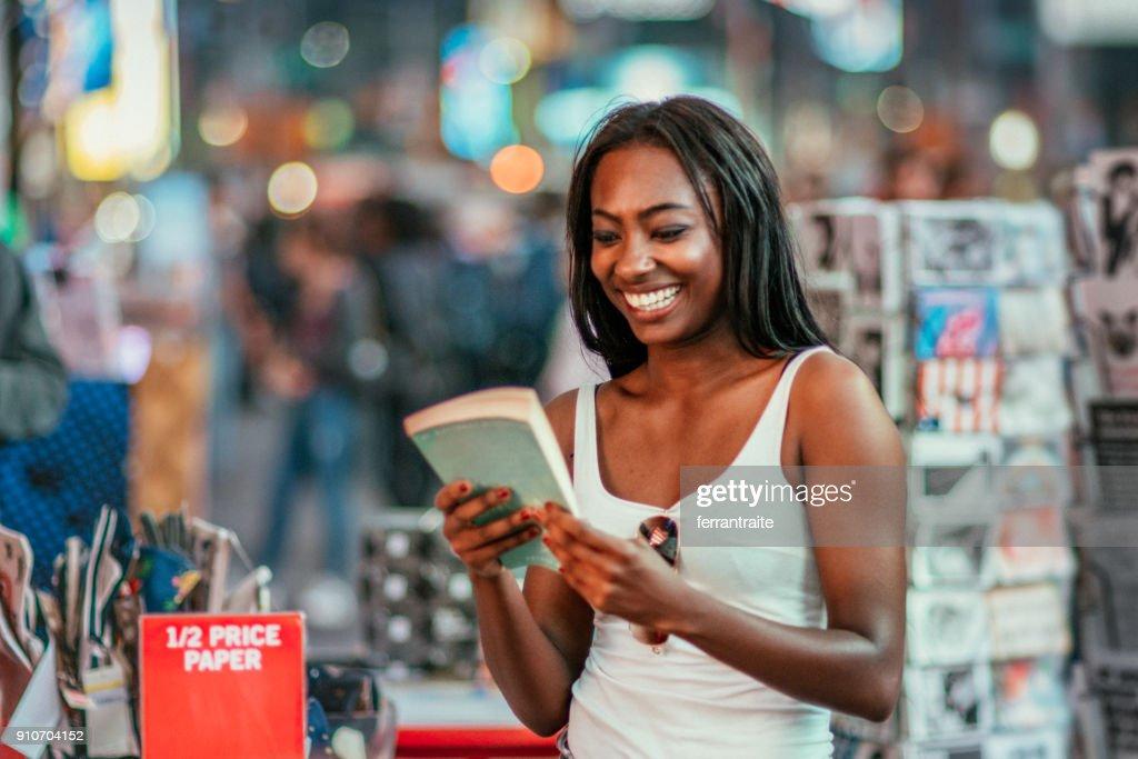 Woman Buying Books : Stock Photo