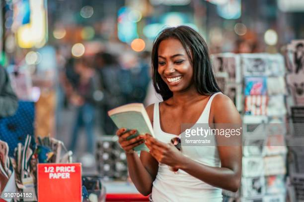 woman buying books - book shop stock pictures, royalty-free photos & images