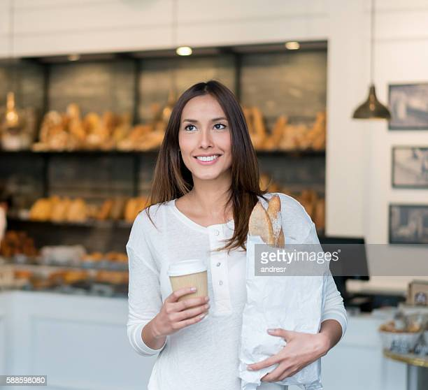 Woman buying bread at the bakery
