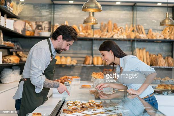 Woman buying cakes at a pastry shop