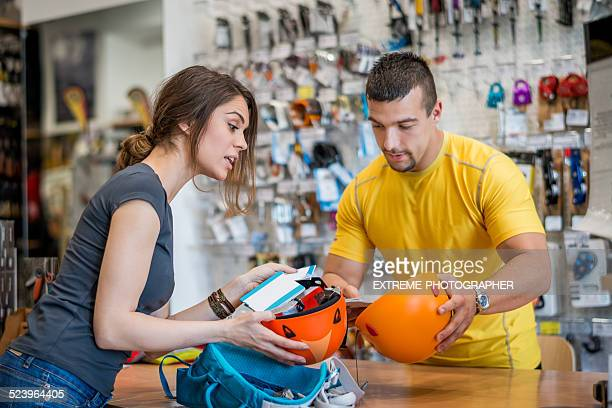 Woman buying canyoning equipment in sports store