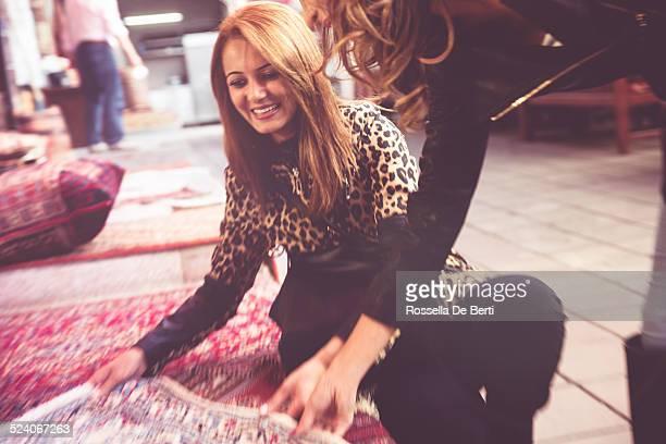 Woman Buying Carpets