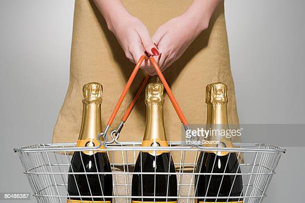 Woman buying champagne