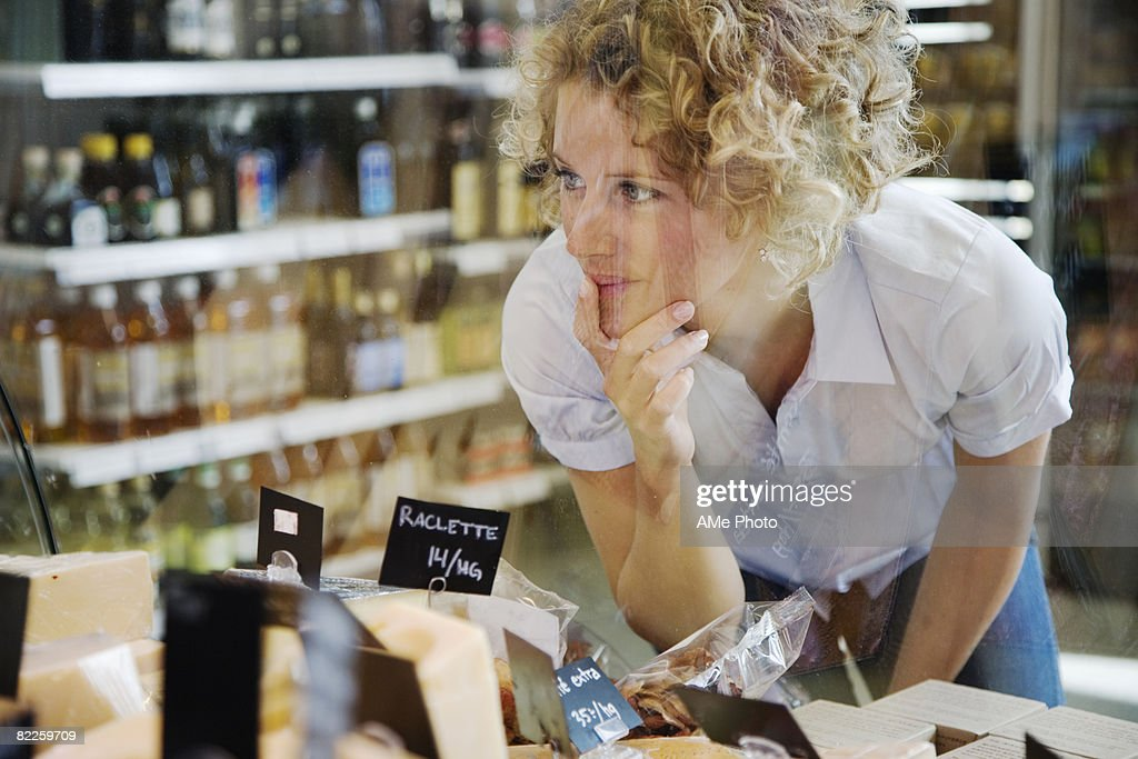 A woman buying cheese Sweden. : Stock Photo