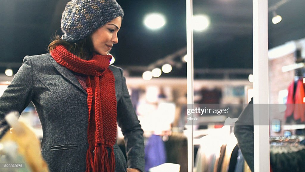 Woman buying clothes at department store. : Stock Photo