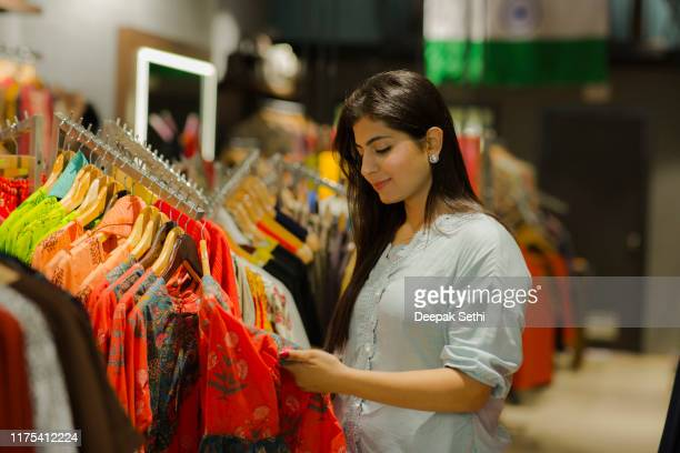 woman buying clothes at department store. stock photo - dress stock pictures, royalty-free photos & images