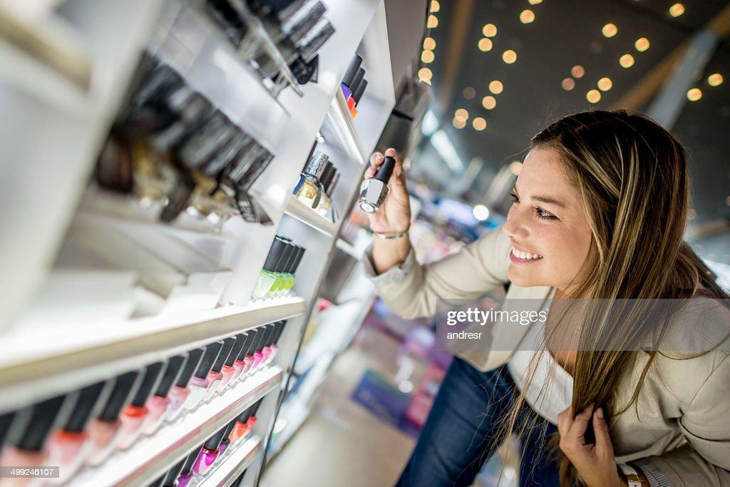 Woman buying cosmetics : Stock Photo