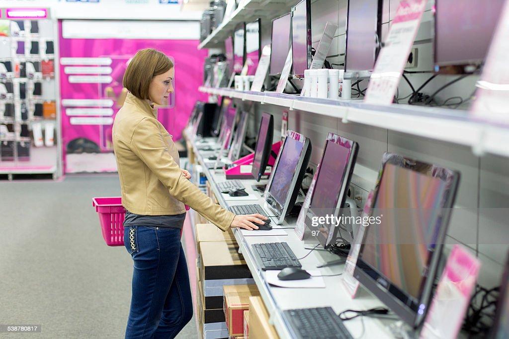woman buying desktop in store : Stock Photo
