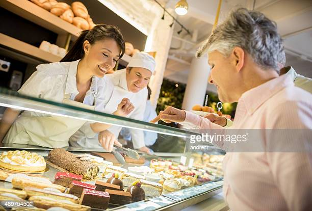 Woman buying desserts at a pastry shop