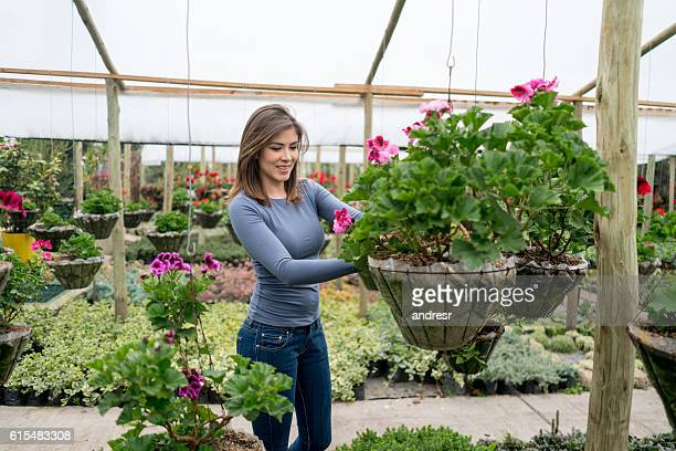 Woman buying flowers at a greenhouse