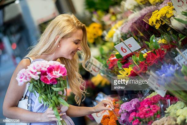 Woman buying flowers at the florist