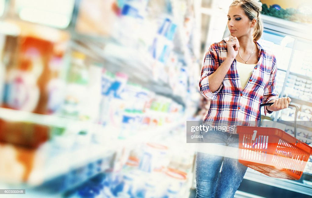 Woman buying food in supermarket. : Stock Photo