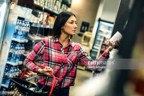 woman buying food - canned food stock pictures, royalty-free photos & images