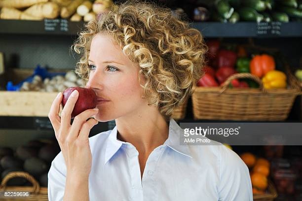 a woman buying food sweden. - apple fruit stock photos and pictures