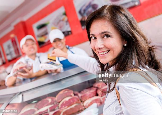 Woman buying fresh steaks