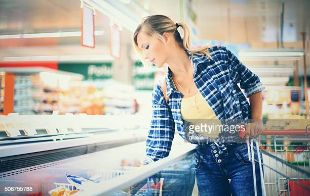 Woman buying frozen food.