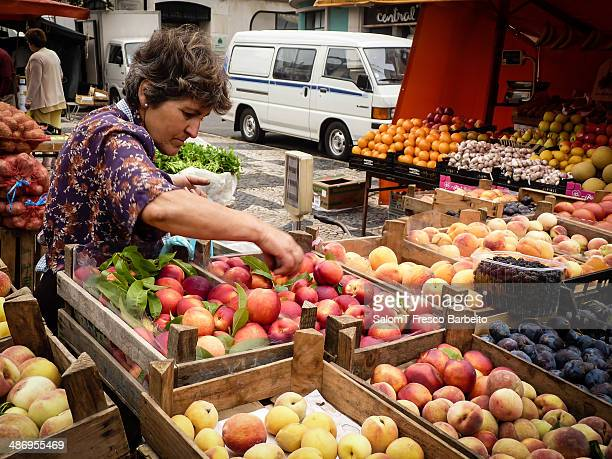 Woman buying fruit in a farmers market Caldas da Rainha Portugal