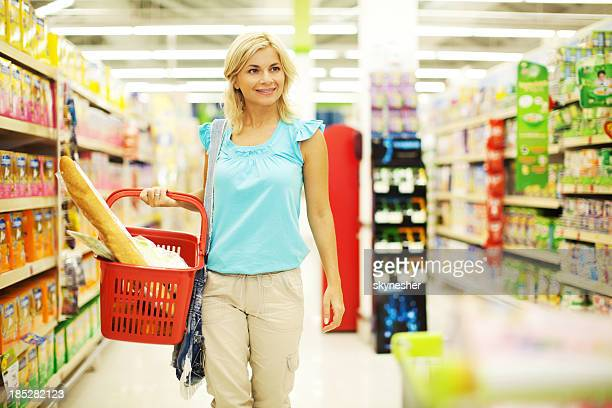 Woman buying groceries at the store.