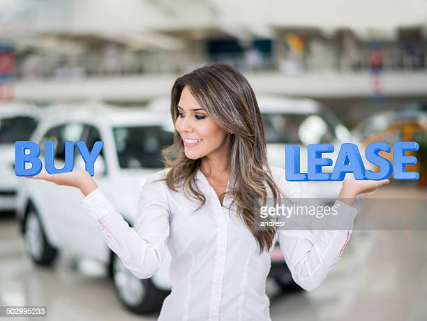 woman buying or leasing a car - lease agreement stock pictures, royalty-free photos & images