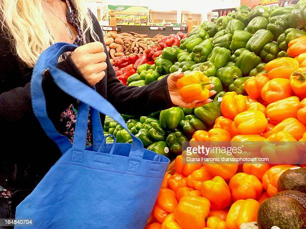 Woman Buying Peppers