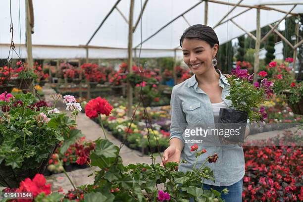 Woman buying plants at a greenhouse
