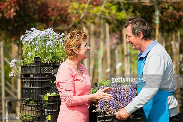 Woman buying plants at garden center