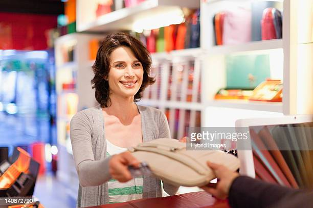 Woman buying purse in store