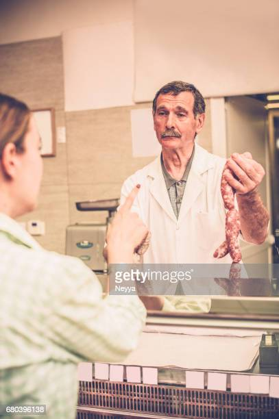 Woman Buying  the Meat at the Butcher Shop