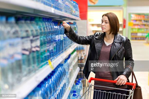 woman buys a bottle of water