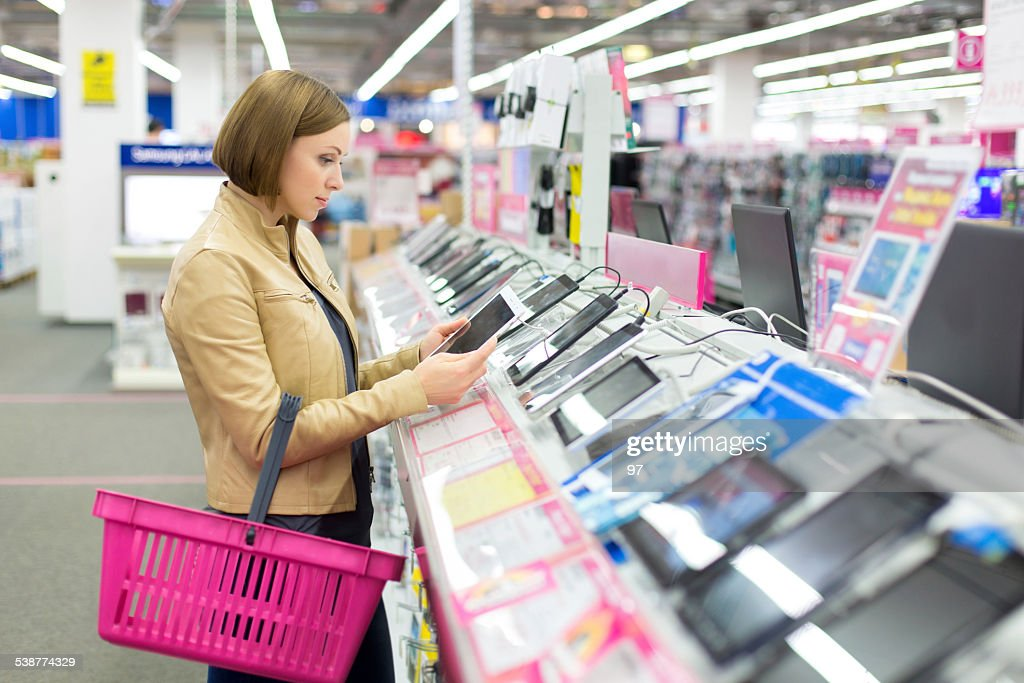 Woman buys a digital tablet : Stock Photo